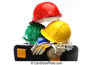 Safety - Some color protective helmets and toolbox on white
