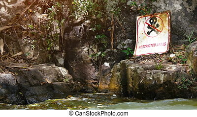 Safety Warning Sign near Waterfall - Skull and crossbones...
