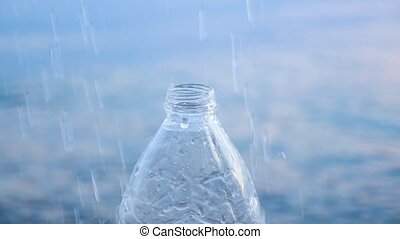 Bottle with water splashes on seawater background. Drink water background. Social art for behaviour change. Mineral water background. Lack of drink water on the earth