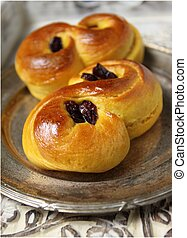 Sweet Swedish buns baked with saffron, cranberries and raisins