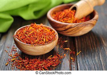 Saffron on wooden background - Saffron in wooden bowl on...
