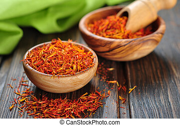 Saffron on wooden background - Saffron in wooden bowl on ...