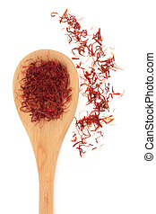 Saffron spice threads in a wooden spoon and scattered isolated white background.