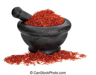 Saffron spice used in cooking and traditional chinese herbal medicine in a black marble mortar with pestle over white background. Hong hua