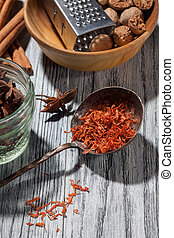 saffron with various spices on wooden background