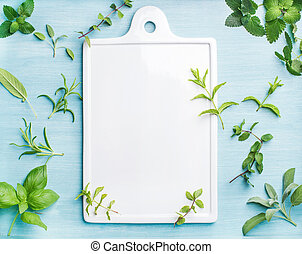 Sage, basil, rosemary, melissa and mint on blue background ...