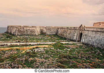 Sagres fortress in rugged terrain - Rugged terrain surround ...
