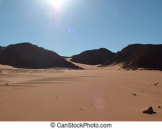 Sahara desert in Egypt - Sand, mountains and blue sky with...
