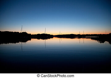 Saiboats silhouette in sunset