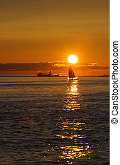 sail and ship at sunset  on Pacific ocean