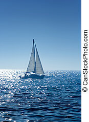 Sail boat - A small  boat sailing on a sunny morning
