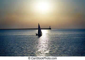 Sail boat against sea sunset. Blue marine landscape.