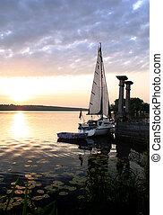 Sail Boat at lake on the sunset