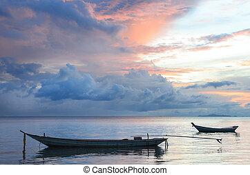 Sail Boat at sunrise beautiful color sky. Indonesia, Bali