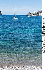 Sail boat in Port de Soller bay Mallorca