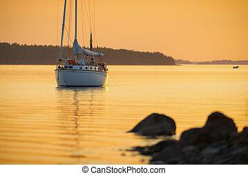 Sail boat in the orange sunset