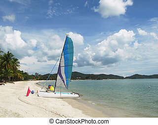 Sail boat on a beach of Langkawi island, Malaysia