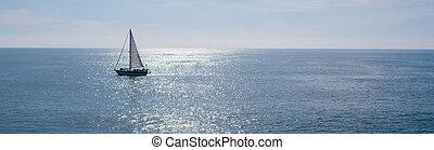 Sail boat on beautiful day