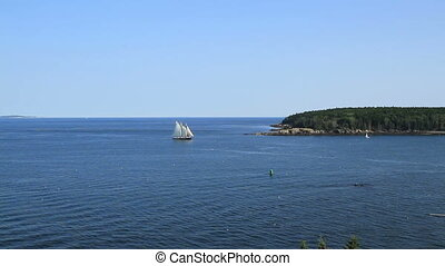 Sail boat on the blue ocean Maine USA scenic ocean view