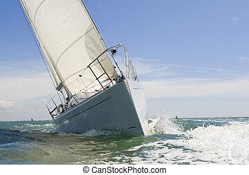Sail Boat Up Close - A beautiful white yachts racing close...
