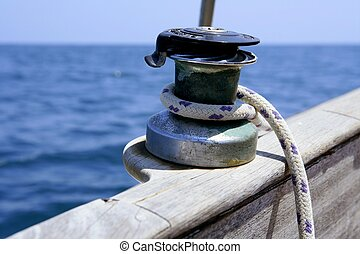 Sail boat winch with marine rope arround