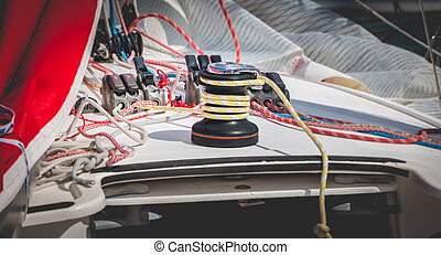 Sail boat winch with yellow rope