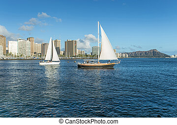 Sail boat with Diamond head mountain Hawaii background