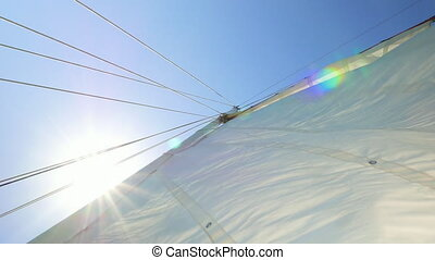Sail Flapping in the Wind - Downward look at the sail with...