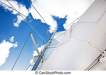Sail of a sailing boat over bue sky