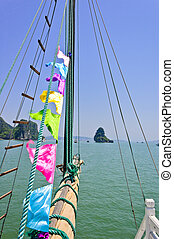 Sail rolled-up and cables