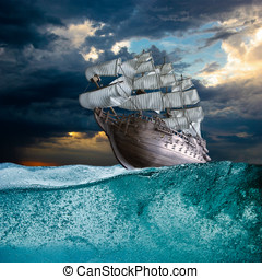 Sail ship in storm sea against heavy sunset clouds