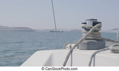 Sail winch and rope on sailing boat in sea close up. Sail...