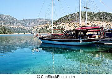 Sail yacht in harbor on Turkish resort, Antalya, Turkey