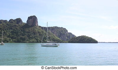 sailboat anchored in ropical island - sailboat anchored in...