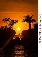 Sailboat at beautiful sunset above the tropical sea....