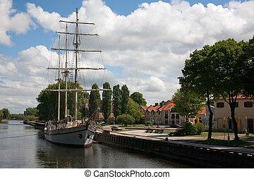 sailboat at city center in the river - Sailboat moored at ...