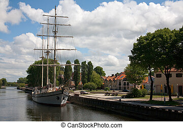 sailboat at city center in the river - Sailboat moored at...
