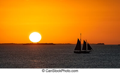 Sailboat at sunset by the coast of Key West