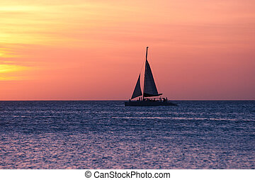 Sailboat at sunset - Image capturing the sunset at sea. A ...