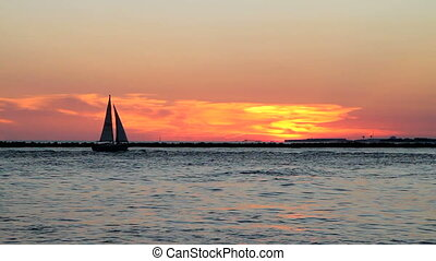 Sailboat Entering Harbor