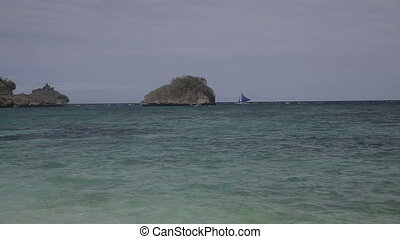 Sailboat floats on sea