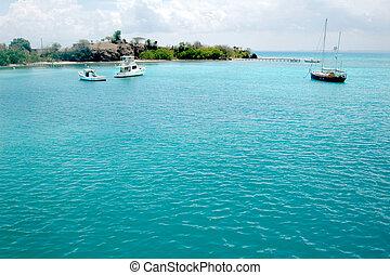 Sailboat in caribbean blue water