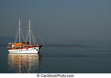 sailboat in sun - beautiful sailboat in morning sunlight