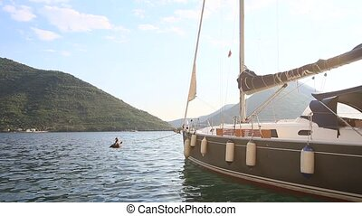 Sailboat in the ancient town of Perast in Bay of Kotor,...