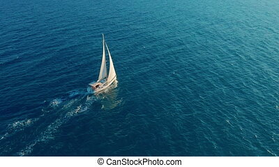 Sailboat in the ocean. White sailing yacht in the middle of...