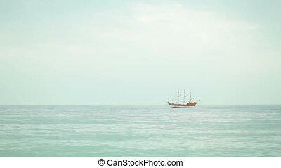 sailboat in the sea at the horizon