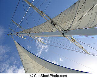 sailboat mast - big sail boat mast under blue sky