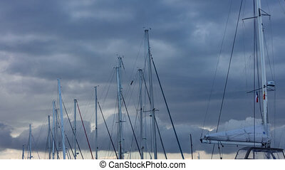 Sailboat mast timelapse against a cloudy stormy Sky - Long...