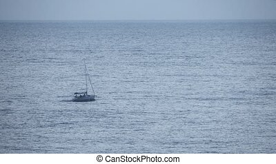 Sailboat moving without sails in the sea - Sailboat moving...