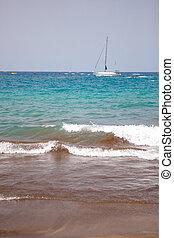sailboat ocean waves